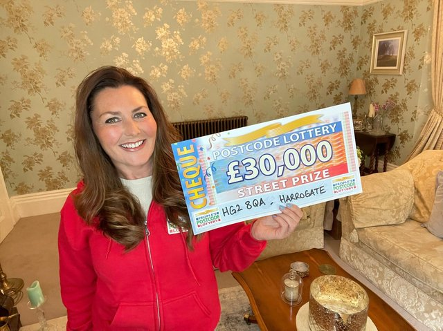 People's Postcode Lottery ambassador Judie McCourt with the cheque for £30,000.