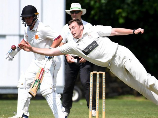 Beckwithshaw CC's Oliver Hotchkiss attempts to take a catch off his own bowling during Saturday's defeat to local rivals Bilton. Pictures: Gerard Binks