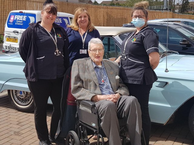 Staff members Lynsey, Hannah and Louise at The Cuttings care home in Harrogate with resident Richard Whitfield and the fabulous vintage car.