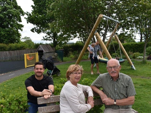Playground refurbishment - Lewis Stokes of The Banks Group with Mary and John Hopkins of the Almscliffe Villages Community Association.