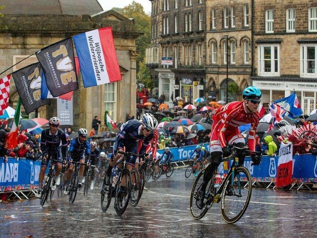 Flashback to 2019 - The Elite Men Road Race peloton passes the Royal Pump Rooms to climb Cornwall Road in Harrogate during in the UCI World Championships.
