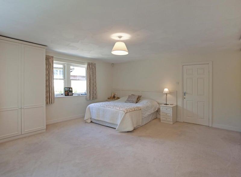 The principal bedroom with built in wardrobes and en-suite bathroom.
