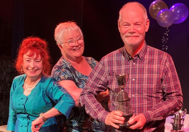 Howard Atkin (Woodlands Drama Group) being presented with the Best Actor Trophy.