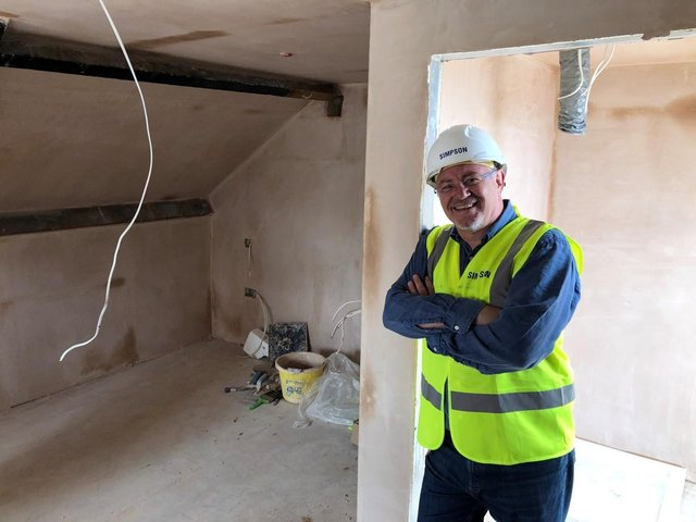 Harrogate Borough Council's deputy leader and cabinet member for resources, enterprise and economic development, Coun Graham Swift, in one of the properties which is currently being regenerated.
