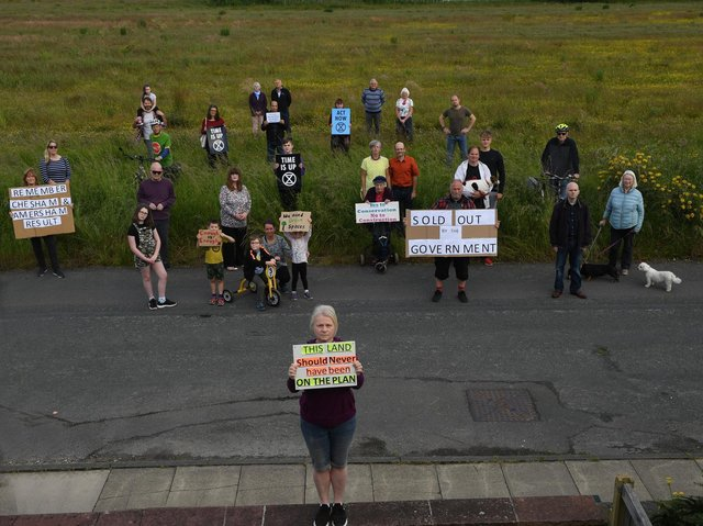 Kingsley protesters, including Catherine Maguire, front, gather at the planned site o the latest new housing development near Kingsley Drive in Harrogate. (Picture Gerard Binks)