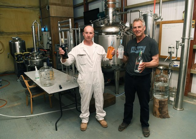 Arable farmer Dave Rawlings, who produces Priory Vodka, on his farm near Tadcaster. Pictured with head distiller Ireneusz Olszewski. Priory Vodka will be on sale at the artisan market in Tadcaster this week. Picture Jonathan Gawthorpe .