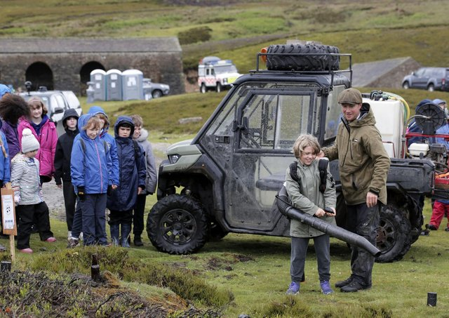 Game keeper Dan Place talk with 9-year-old Eddie Harrison of Hackforth and Hornby School at the 'Let's Learn Moor' event near Grinton on the Yorkshire Moors.