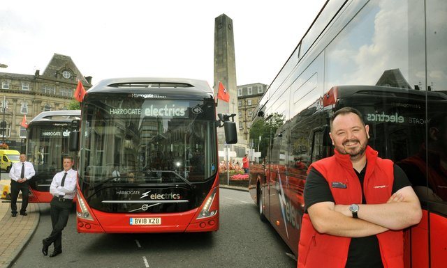 Alex Hornby Chief Executive of Transdev  with some of the new electric buses to be used around Harrogate on show in the town.