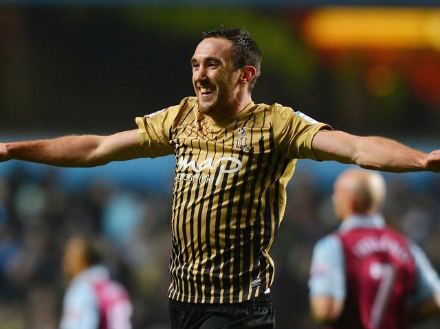 Rory McArdle celebrates Bradford City's 2013 League Cup giant-killing of Aston Villa. Pictures: Getty Images