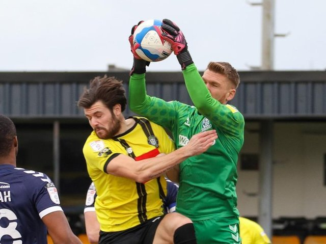 Mark Oxley climbs highest to beat Connor Hall to the ball during Southend United's League Two victory over Harrogate Town on March 27. Pictures: Matt Kirkham