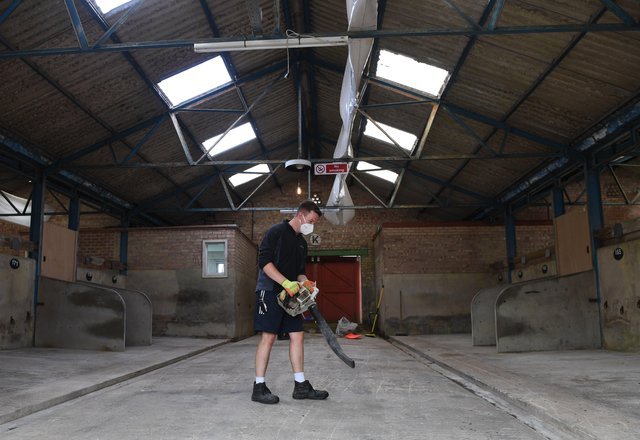 5th July 2021Great Yorkshire Show preparations.Pictured James Porter one of the facilities team cleaning the cattle shedsPicture Gerard Binks