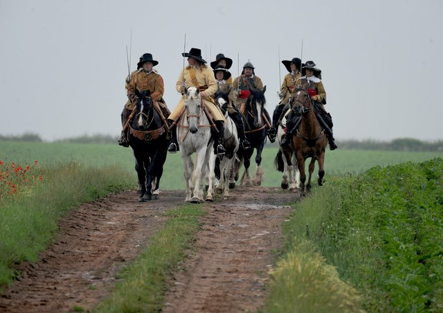 3rd July 2021Equistry and The Troop bring history to life as they commemorate the 377 thanniversary of the Battle of Marston Moor. At noon, they will be giving a brief historical talk outsidethe Boot and Shoe Inn, Tockwith before riding to the battlefield and memorial. This charity ride issupporting Brooke, an international charity that protects and improves the lives of horses, donkeysand mules which give people in the developing world the opportunity to work their way out ofpoverty.Pictured the group on the battlefield at Marsden Moor.Picture Gerard Binks