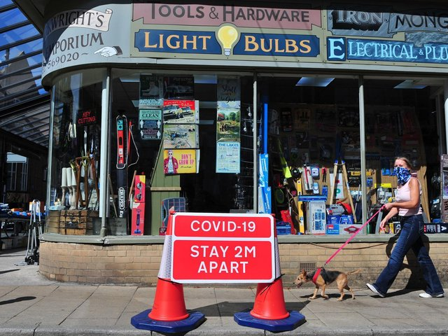 The Covid-19 rules street sign outside Arkwright's Emporium shop on Commercial Street, Harrogate looks set to become ancient history. Picture Gerard Binks