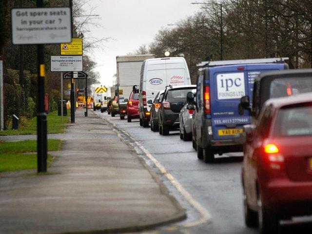 Traffic on Leeds Road in Harrogate - North Yorkshire County Council's Carbon Reduction Plan aims to reduce its carbon footprint but will it go far enough to achieve fundamental change in the county?
