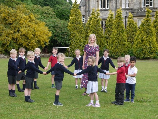 Happy retirement - Nursery teacher Ann Regan says farewell to pupils at Belmont Grosvenor School in Harrogate after 25 years of caring for hundreds of children.