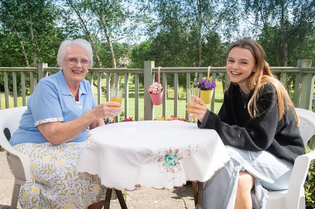 Sophie Westwood, 17, is part of the phone call support group with Pat McArthur, 83, a former school teacher.