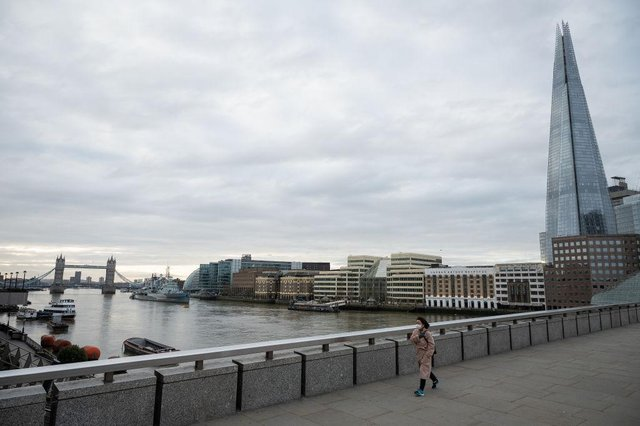 A woman crosses London Bridge during what would usually be the busy pre-9am rush-hour (Photo: Leon Neal/Getty Images)